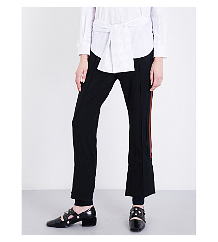 TOGA Stepped-hem high-rise flared cotton-blend trousrs (Black