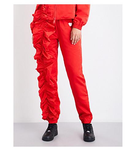 NICOPANDA Park Jog skinny high-rise shell trousers (Red