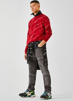 The model is wearing a Balenciaga jumper and jeans.