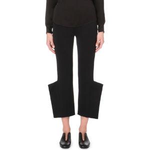 Tapered asymmetric-hem stretch-knit trousers