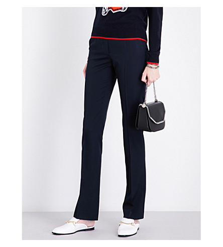 STELLA MCCARTNEY Jodi slim-fit mid-rise wool-piqué trousers (Ink