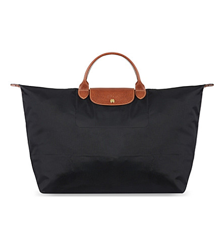 ... LONGCHAMP Le Pliage medium travel bag in black (Black. PreviousNext 14459aee0b
