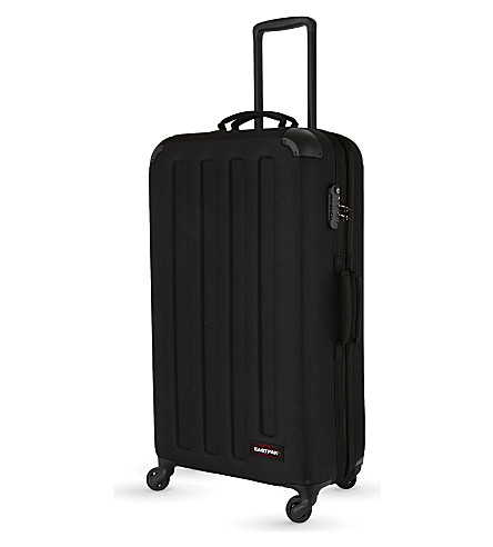 EASTPAK Tranzshell large four-wheel suitcase 77cm (Black