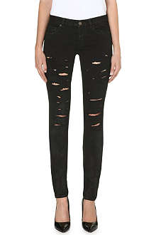 SAINT LAURENT Destroyed skinny mid-rise jeans