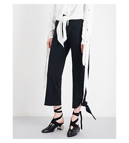 JW ANDERSON Knot-hem straight high-rise gabardine trousers (Black