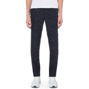 Slim-fit tapered floral-jacquard linen-blend trousers