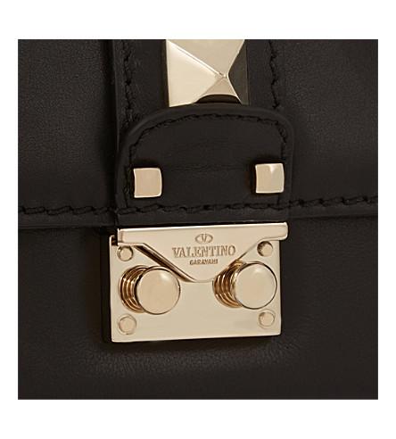 valentino rockstud lock mini clutch bag in black modesens