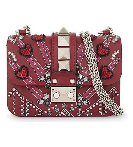 VALENTINO Embellished leather cross-body bag (Rubino