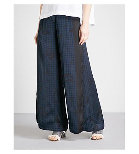 SACAI Grid-pattern high-rise flared satin trousers (Black/navy
