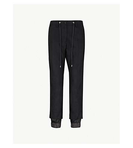 SACAI Relaxed-fit wool-blend and shell jogging bottoms (Black/black