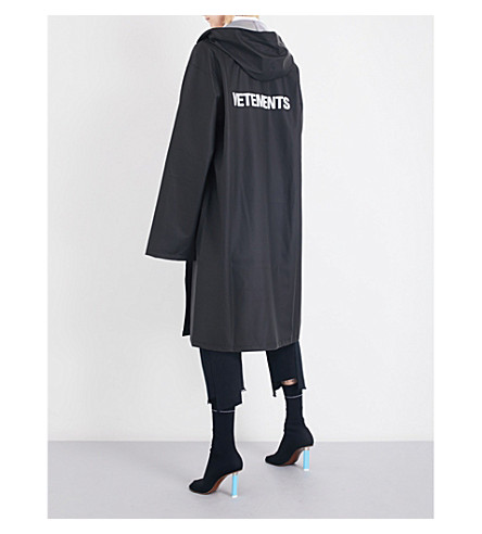 VETEMENTS Logo-print oversized PVC raincoat (Black