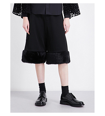 NOIR KEI NINOMIYA Faux fur-trim wide-leg wool shorts (Black