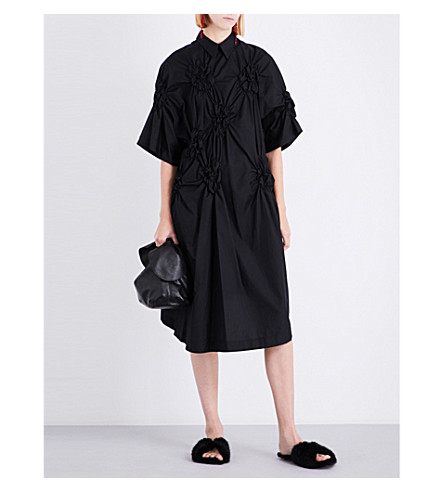SIMONE ROCHA Flower-smocked cotton dress (Black