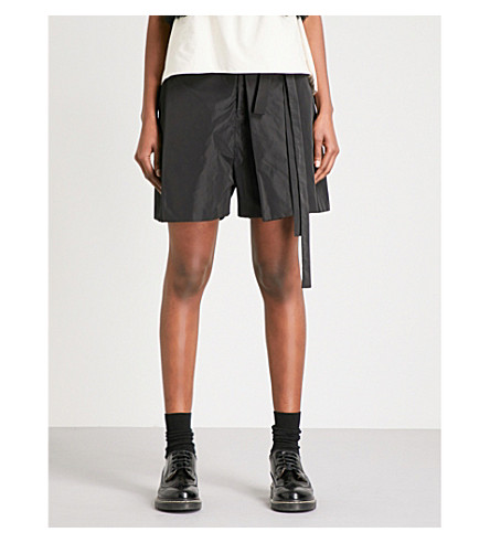 PHOEBE ENGLISH Folded-detail relaxed-fit taffeta shorts (Black