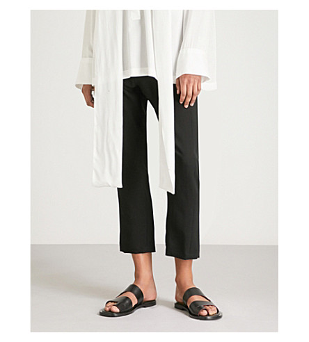 ANN DEMEULEMEESTER Tapered high-rise wool cropped trousers (Black