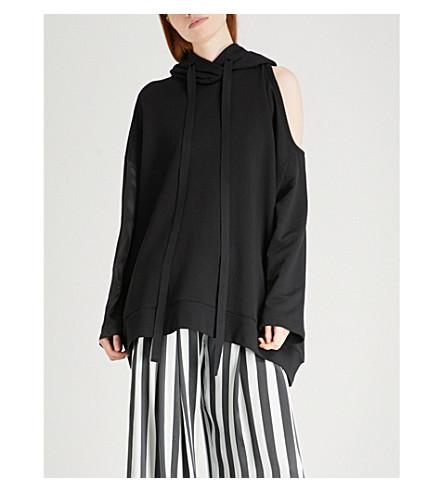ANN DEMEULEMEESTER Cold-shoulder oversized cotton-blend hoody (Black/black