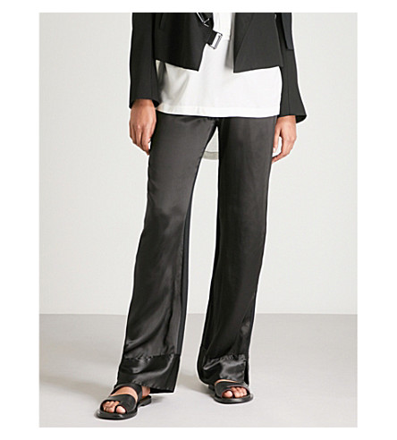 ANN DEMEULEMEESTER Relaxed-fit high-rise silk and cotton trousers (Black/black
