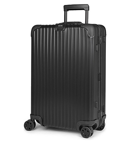 RIMOWA Topas Stealth four-wheel suitcase 68cm (Black