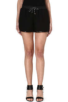 JONATHAN SIMKHAI Leather-trimmed crepe shorts