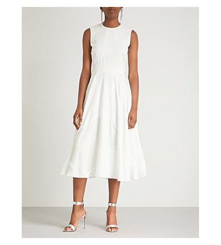 ROKSANDA和闪光的丝绸礼服 (象牙
