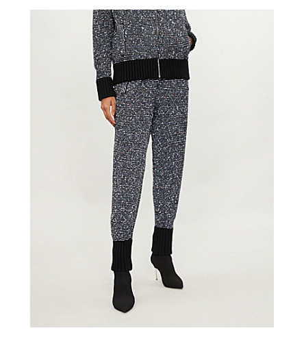 ALESSANDRA RICH Metallic and sequin-knit cashmere-blend jogging bottoms (Black