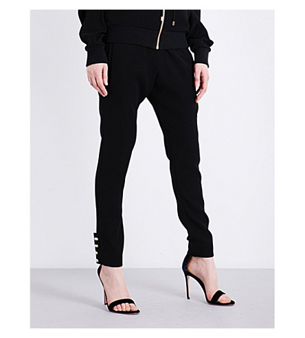 ALEXANDRE VAUTHIER Buttoned-cuff high-rise woven jogging bottoms (Black