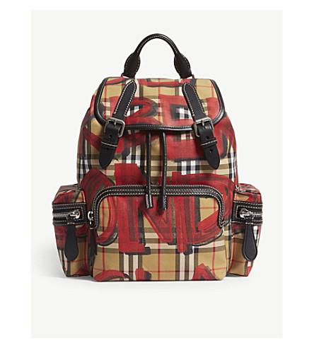 d979d5b3c50 ... BURBERRY Graffiti-print vintage check canvas backpack (Black+red.  PreviousNext