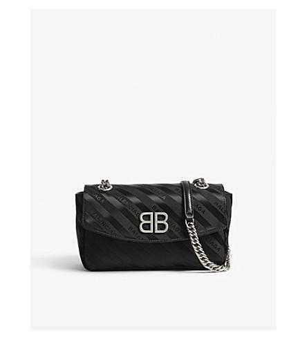 BALENCIAGA Striped logo canvas shoulder bag (Black