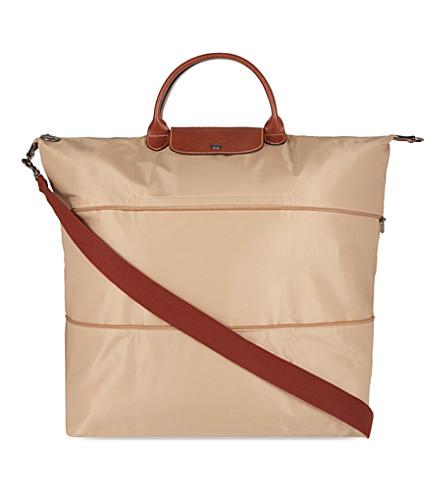 f8f6b8f08697 ... LONGCHAMP Le Pliage expandable travel bag (Beige. PreviousNext