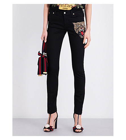 GUCCI Tiger-embellished skinny mid-rise jeans (Black+denim