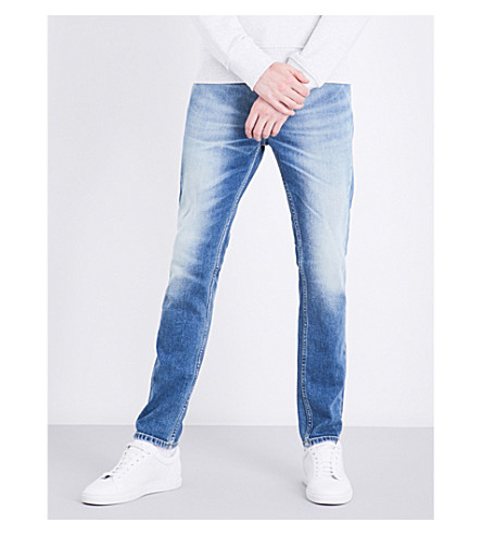 CALVIN KLEIN Skinny tapered mid-rise jeans (Twister+blue
