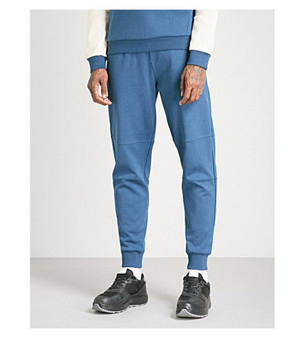 THE NORTH FACE Logo-patch tapered cotton-jersey jogging bottoms (Blue+wing+teal