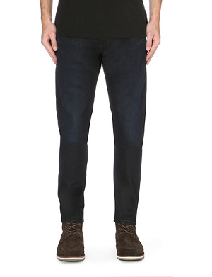 LEVI'S 520 Extreme Taper regular-fit tapered mid-rise jeans