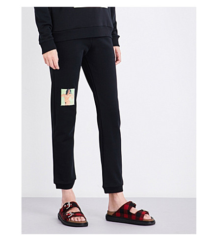CHRISTOPHER KANE Portrait-print high-rise cotton-jersey jogging bottoms (Black