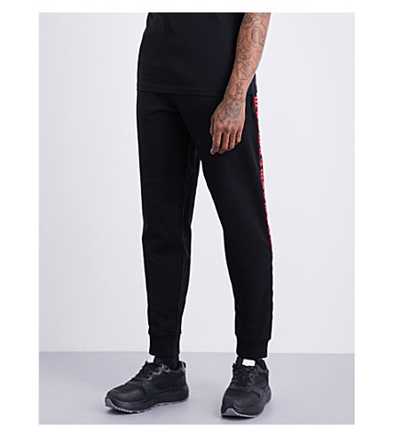 MCQ ALEXANDER MCQUEEN Gothic-text cotton-jersey jogging bottoms (Black+red