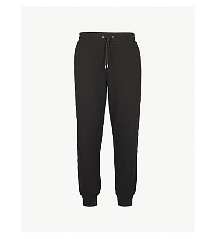 MCQ ALEXANDER MCQUEEN Logo-embroidered cotton-jersey jogging bottoms (Darkest+black