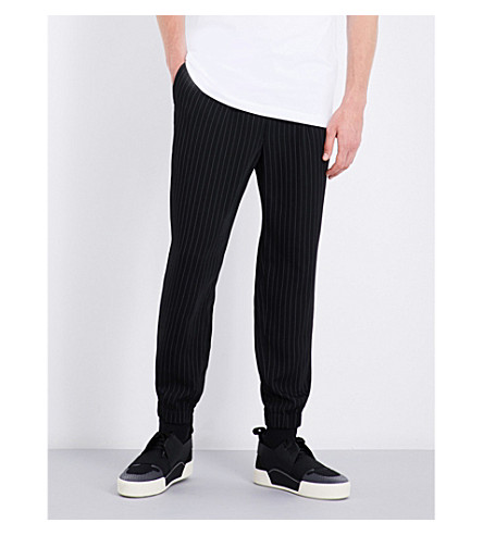 MCQ ALEXANDER MCQUEEN Pinstripe woven jogging bottoms (Darkest+black