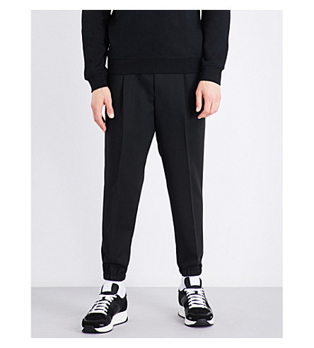 MCQ ALEXANDER MCQUEEN Tailored wool jogging bottoms (Darkest+black
