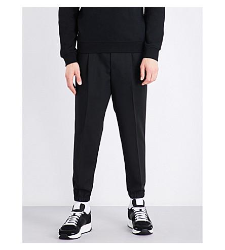 MCQ ALEXANDER MCQUEEN Tailored wool track pants (Darkest+black