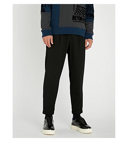 MCQ ALEXANDER MCQUEEN Straight-leg jersey jogging bottoms (Darkest+black