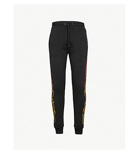 CRIMINAL DAMAGE Blaze fire-print jogging bottoms (Black