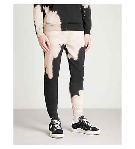 CRIMINAL DAMAGE Bleach distressed cotton-fleece jogging bottoms (Black+tan