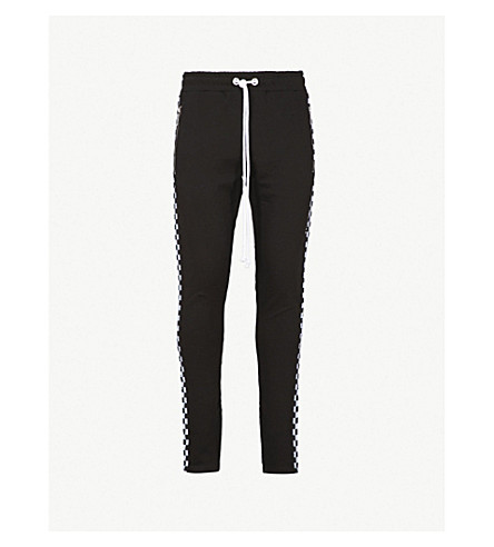 CRIMINAL DAMAGE Chequer cotton-jersey jogging bottoms (Black white