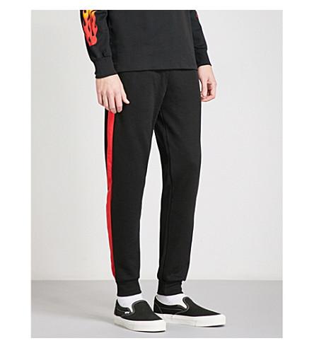 CRIMINAL DAMAGE Hater jersey jogging bottoms (Black+red