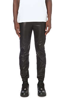 CRIMINAL DAMAGE Faux-leather jogging bottoms