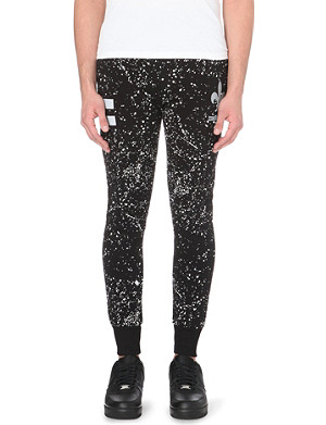 CRIMINAL DAMAGE Reflective splatter stretch-cotton jogging bottoms