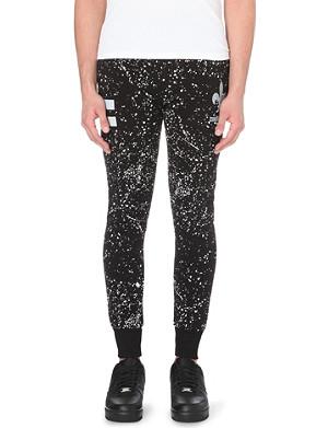 CRIMINAL DAMAGE Reflective splatter stretch-cotton jogging bottoms