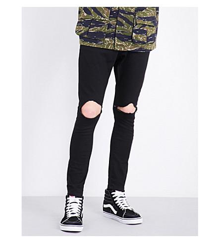 MAGIC STICK Ripped-knee slim-fit skinny jeans (Black