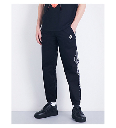 MARCELO BURLON Geometric-print relaxed-fit cotton-twill jogging bottoms (Black+white