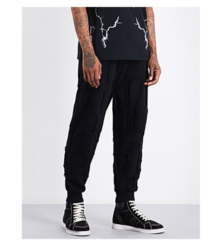 MARCELO BURLON Frayed-detail relaxed-fit mid-rise cotton-jersey jogging bottoms (Black+no+colour